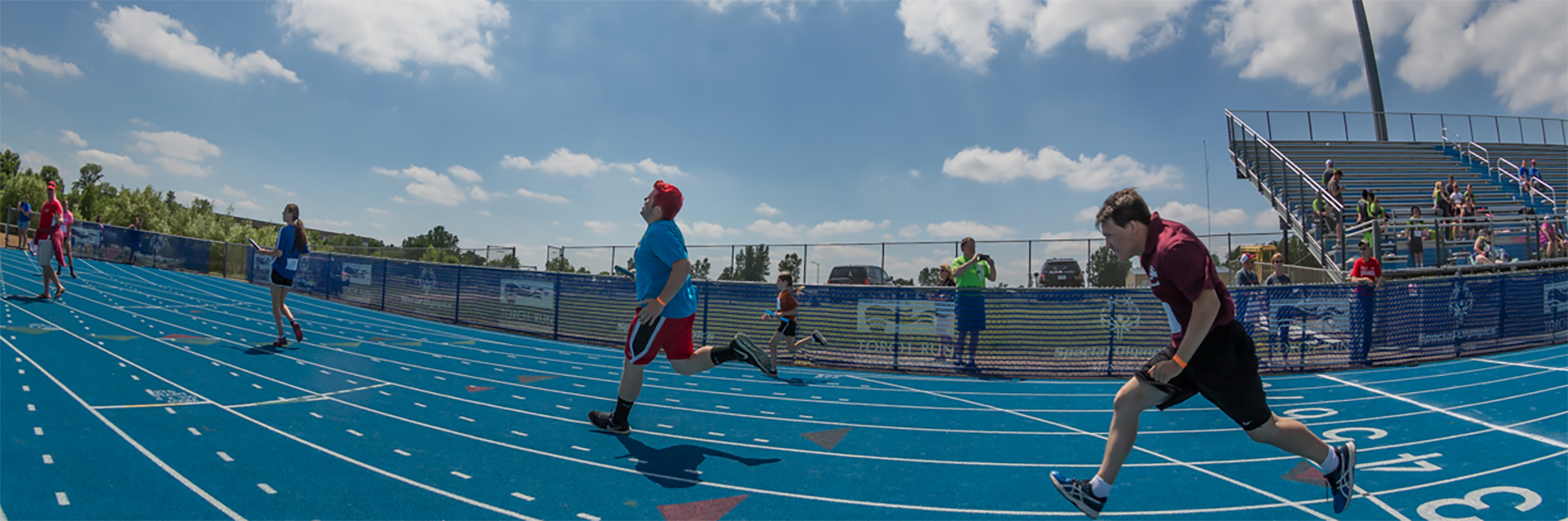 Special Olympics Minnesota track athletes running race