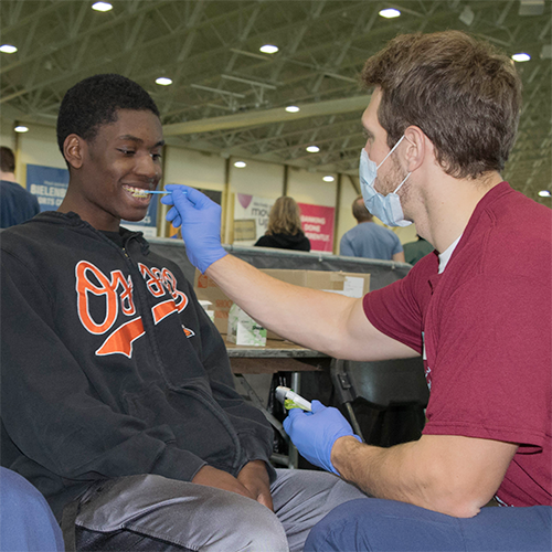 Special Olympics Minnesota athlete being examined by volunteer at Healthy Athletes screening