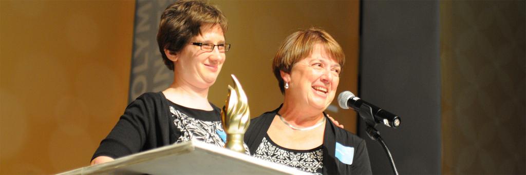 Group of Distinguished Service Awards speaker with award winner